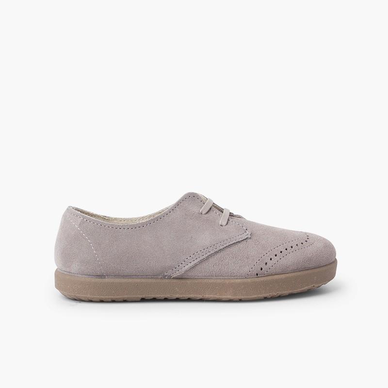 Chaussures blucher en suède avec motifs piqués sur le bout